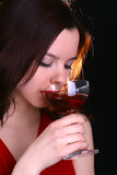 Lady in red. Lady with a glass of red wine Royalty Free Stock Photo