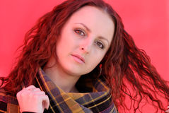 Lady in red. Young woman on red background with red reflex on her face Stock Photo