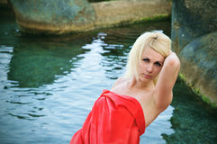Lady in red on the beach Royalty Free Stock Photos