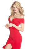 Lady In Red. Beautiful woman in red dress with long blond hair. Fashion over white background Stock Images