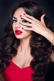 Lady in red. Beautiful woman portrait in red dress, with red lips and accessories. Lady in red. Beautiful woman portrait in red dress with red lips and Stock Photography