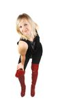 Lady in red boots dancing Stock Photo