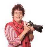 Lady In Red With A Camera. High-key portrait of a lady photographer dressed predominately in red Stock Images