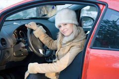 Lady in red car Stock Photos