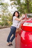 Lady with a red car Stock Photos