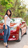 Lady with a red car Stock Photo