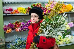 Lady in Red - Chelsea Flower Market - New York City stock photos