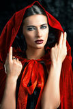 Lady in red cloak Stock Photo
