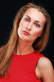 Lady in red close up portrait on black Royalty Free Stock Photo