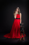 Lady in red with doberman Royalty Free Stock Photos
