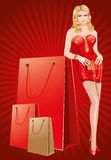 Lady in red does the shopping Stock Image