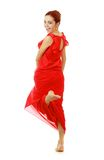 Lady in red dress Stock Image