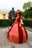 Lady in red dress. At statue of Peter I in Saint Petersburg Royalty Free Stock Photos