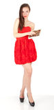 Lady in red dress with box of chocolates Royalty Free Stock Photos