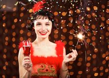 Lady in red dress at the carnival Stock Photo