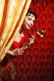 Lady in red dress at the carnival with mask Stock Image
