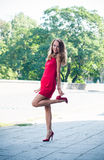 Lady in red dress dancing Stock Photos