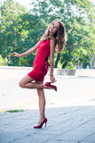 Lady in red dress dancing Stock Images
