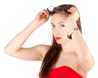 Lady in red dress with eyeglasses Royalty Free Stock Image