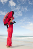 Lady red dress umbrella beach Royalty Free Stock Images