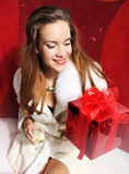 Lady with red gift and champagne Royalty Free Stock Photo