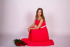 Lady in Red. / Girl with roses Royalty Free Stock Image