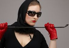 Lady in red gloves with crop #2. Portrait of lady in black headscarf and red gloves with crop stock image