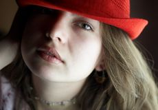 Lady with red hat. Girl with a red hat, close up royalty free stock photography