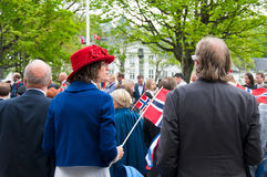 The lady and red hat. The festively dressed couple at norwegian constitution day during parade royalty free stock images