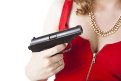 Lady in red holding a pistol Royalty Free Stock Photos