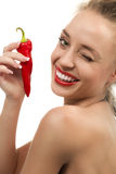 Lady with red hot chilli pepper. Young lady with red hot chilli pepper Royalty Free Stock Photos