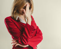 Lady in red jacket failure stock photos