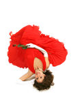 Lady in red laying down. Lady in red dress and white gloves laying down isolated on white background Stock Photo