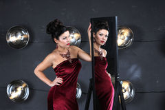 Lady in red and magic mirror Royalty Free Stock Photo