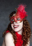Lady in a red mask Stock Photos