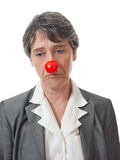 Lady with red nose. Mature lady with red nose looking down on white background Stock Photos