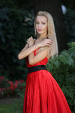 Lady in red outdoors Royalty Free Stock Images