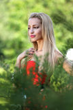Lady in red outdoors Royalty Free Stock Image