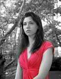 Lady in red in park. Lady dressed in red while visiting Central Park in New York City.  She is Jewish American and was in her early twenties at the time of shoot Stock Image