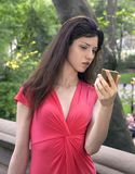 Lady in red in park Royalty Free Stock Image