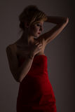 Lady in red posing for fashio Royalty Free Stock Image