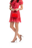 Lady with red purse. Summer dress with short sleeves. Brand new heel shoes. Youth and charm Stock Photos