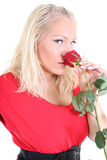 Lady in red with red rose Royalty Free Stock Image