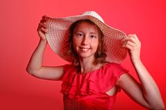 Lady in red with summer hat Royalty Free Stock Image