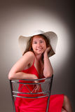 Lady in red with summer hat Royalty Free Stock Photo