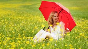Lady with a red umbrella stock footage
