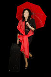 Lady with red umbrella standing on one leg Stock Images