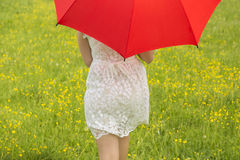 Lady with a red umbrella Royalty Free Stock Photography