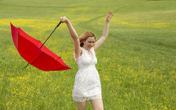 Lady with a red umbrella Stock Image