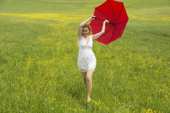 Lady with a red umbrella Stock Images